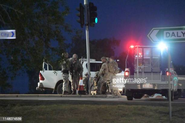 Suspect is held down by police after a shooting in Darwin, Northern Territory. Four people were killed.