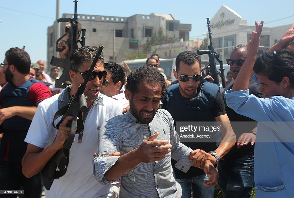A suspect man is arrested after an armed attack on a tourist hotel in Sousse, east Tunisia, left at least 27 people dead, including foreigners, and injured six others , on June 26, 2015.