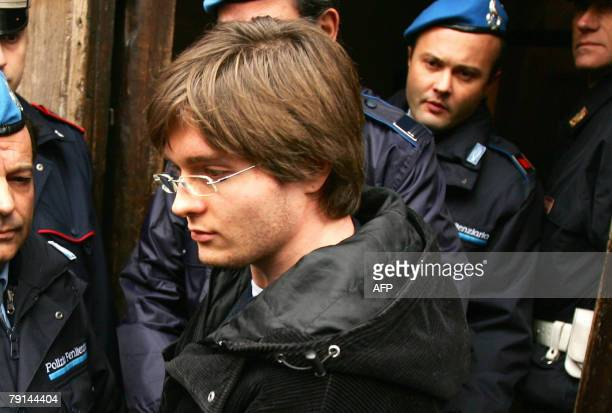 Suspect Raffaele Sollecito is accompanied by penitentiary police upon his arrival for a hearing with magistrates in charge of the case of British...