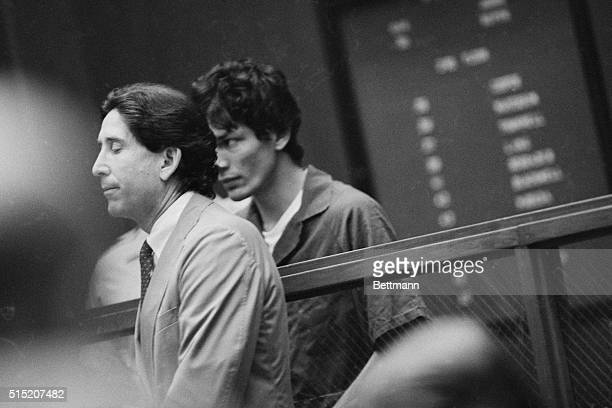 Suspect Richard Ramirez accused of being the Los Angeles area serial killer called the Night Stalker in courtroom with his public defender Alan...
