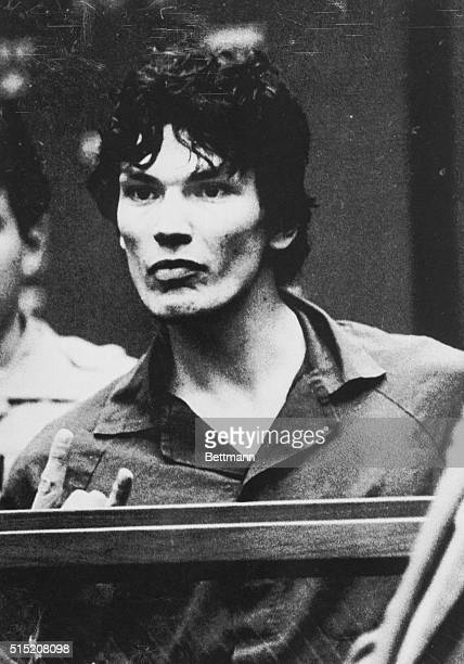 Suspect Richard Ramirez accused of being the Los Angeles area serial killer called the Night Stalker gesturing in courtroom Ramirez pleaded innocent...