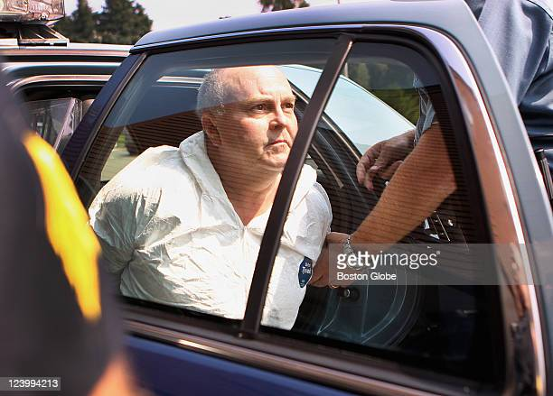 Suspect Roy Limbaugh is escorted into Danvers Police Department on Friday August 19 2011 Limbaugh will be arraigned on charges of stabbing Danvers...