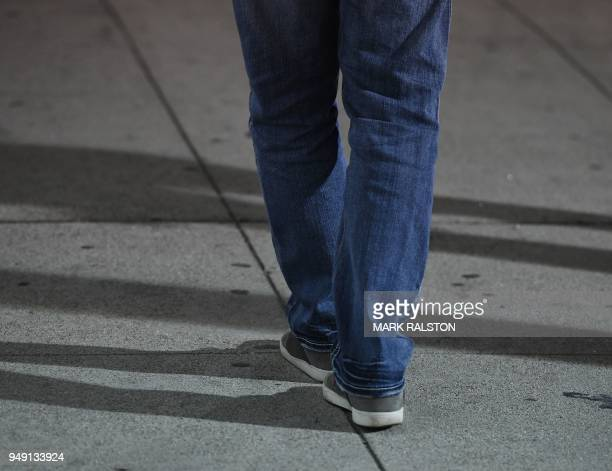 A suspect tries to walk a straight line during a sobriety test at a LAPD police DUI checkpoint in Reseda Los Angeles California on April 13 2018 Pot...