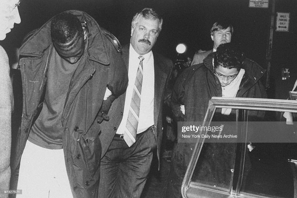 Suspect Yusef Salaam (l.) is led away by a detective after being arrested in Central Park for allegedly attacking a jogger.