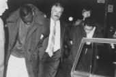 Suspect yusef salaam is led away by a detective after being arrested picture id97327571?s=170x170