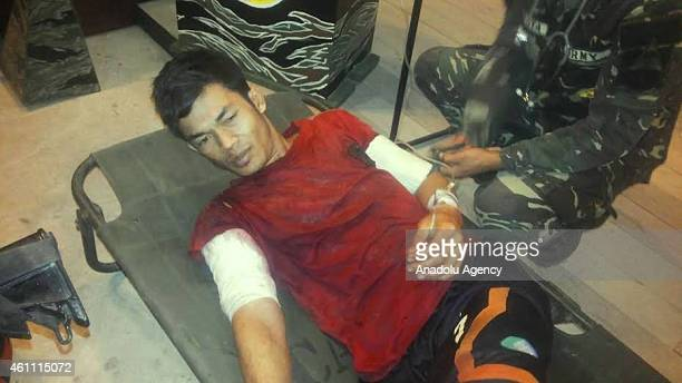 Suspected Abu Sayyaf leader Imran Daiyong Mijal is treated at the base of the 4th Special Forces Battalion following he has been shot and wounded...
