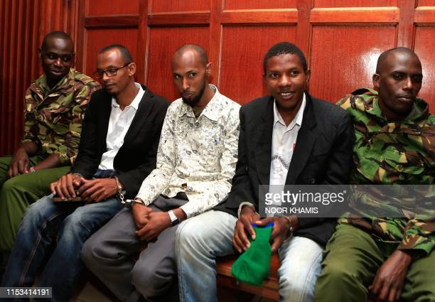 Suspected accomplices Hassan Aden Hassan Mohamed Ali Abdikar and Rashid Charles Mberesero sit and wait for sentencing of abetting Somali jihadists...