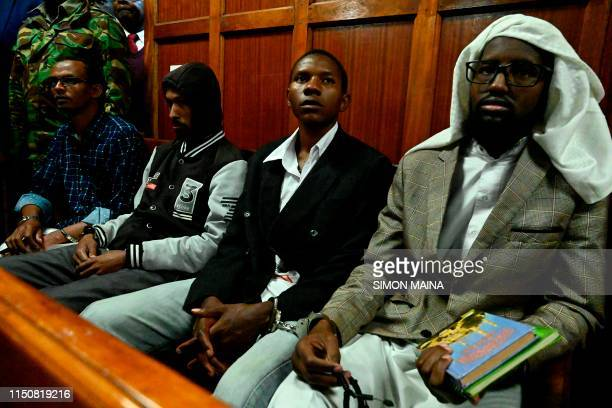 Suspected accomplices Hassan Aden Hassan Mohamed Ali Abdikar Rashid Charles Mberesero and Sahal Diriye Hussein attend their trial at a Nairobi court...
