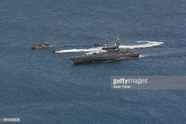 Suspected asylum seeker vessel arrives at Flying Fish Cove Christmas Island after being intercepted and escorted by the Australian Navy on September...