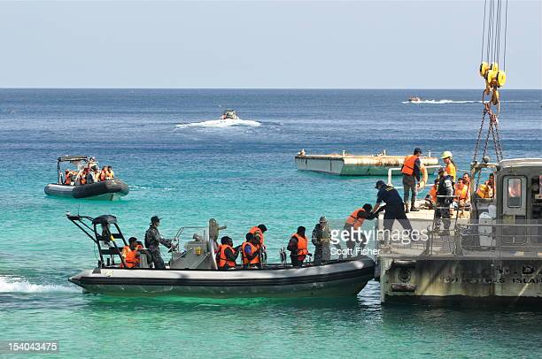 Suspected asylum seekers arrive at Christmas Island after receiving assistance by Australian Navy on October 13 2012 on Christmas Island Reports...