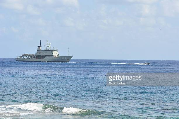 Suspected asylum seekers arrive at to Flying Fish Cove Christmas Island after being intercepted and escorted in by the Australian Navy on August 3...