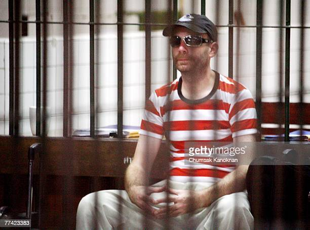 Suspected Canadian paedophile Christopher Paul Neil sits behind bars at the criminal court on October 20 in Bangkok Thailand The Canadian school...