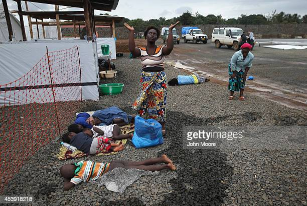 Suspected Ebola patient Finda Zanabo prays over her sick family members before being admitted to the Doctors Without Borders Ebola treatment center...