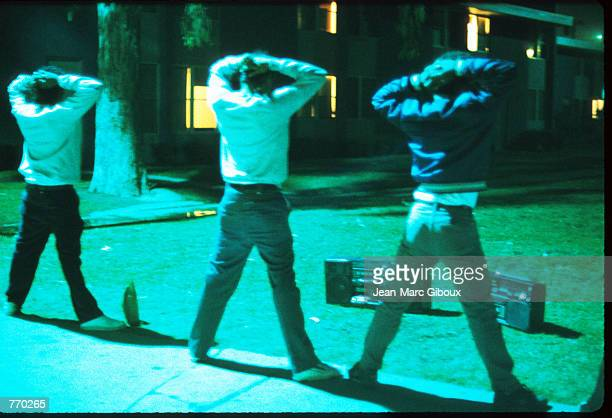 Suspected gang members stand with their hands on their heads June 10 1988 in Los Angeles CA The Los Angeles Police Department swept through...