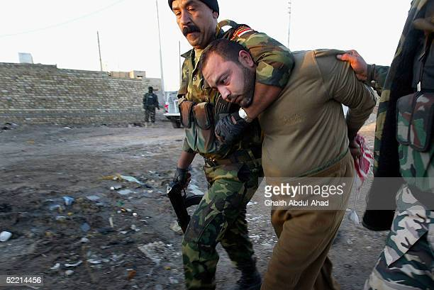 A suspected Iraqi insurgent is detained by commandos of the 3rd battalion of the Commandos brigade after raids against suspected insurgents 30km...