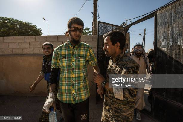 Suspected IS fighter seen being taken for interrogation by SDF fighters in Raqqa.