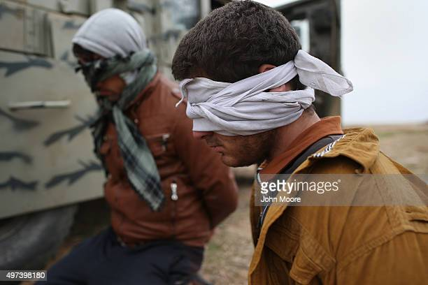 Suspected ISIL or Daesh are detained by Kurdish Peshmerga forces after they fled their frontline village to a Kurdishcontrolled area on November 16...
