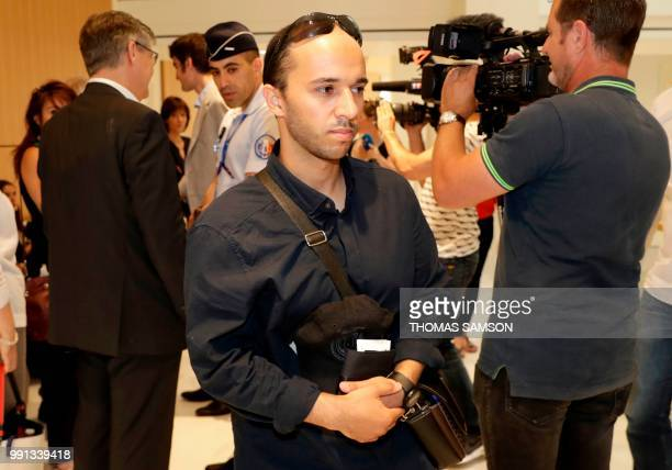 Suspected Islamic extremist Farouk Ben Abbes arrives at 'Palais de Justice' courthouse in Paris on July 4 2018 ahead of his trial in which along with...