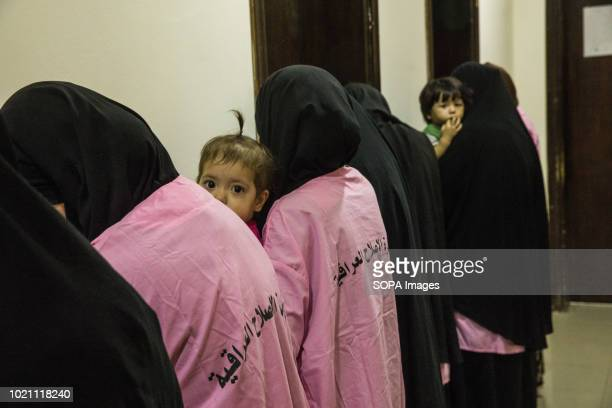 Suspected Islamic State widows seen inside a small waiting room in a Baghdad court The forthcoming of Caliphate soldiers and their families