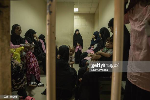 Suspected Islamic State widows seen inside a small waiting room in a Baghdad court