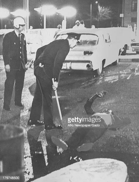 A suspected looter lay down during riots Baltimore Maryland April 9 1968