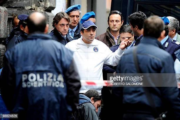 Suspected mafia hitman and presumed killer of Camorra boss Mariano Bacioterracino, Costanzo Apice , is escorted by police during a reconstruction...
