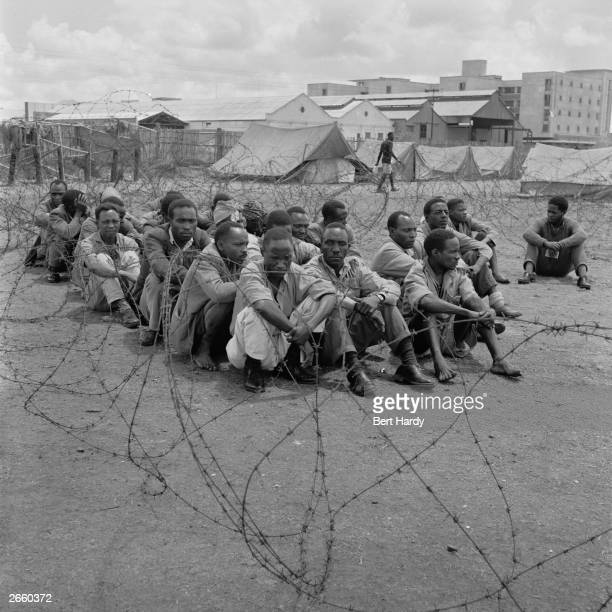 Mau Mau suspects at a 'Special Effort Camp' in Nairobi Kenya Original Publication Picture Post 6223 Mau Mau Get Out Get Out pub 1952