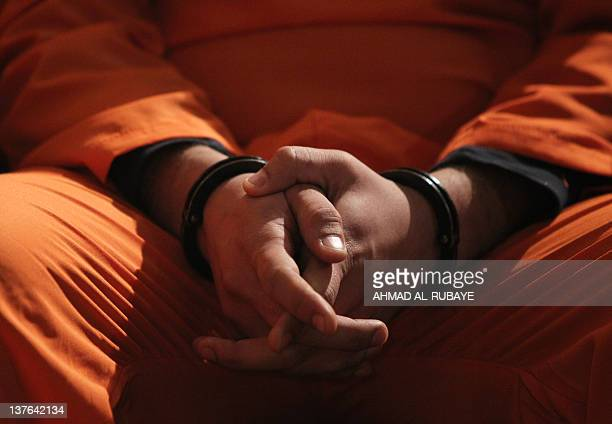 A suspected member of Iraq's Naqshbandi group sits handcuffed at a press conference following his arrest in Baghdad on January 3 2012 Iraq's interior...