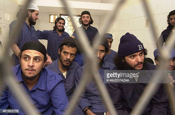 Suspected members of AlQaeda in Yemen sit behind bars during the second hearing of their trial at a court in Sanaa 01 March 2006 The 17 defendants...