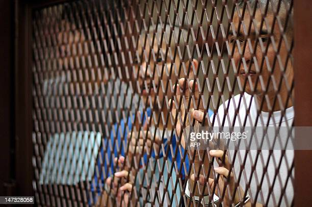 Suspected members of the Mexican drug cartel 'Los Zetas' from Guatemala and Mexico wait in court for a judgement in Guatemala City on June 27, 2012....