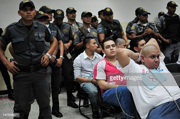 Suspected members of the Mexican drug cartel 'Los Zetas' from Guatemala and Mexico are guarded by police as they wait in court for a judgement in...