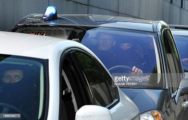 Suspected murderer Tony Meilhon is escorted by members of the French police special forces as he leaves the courthouse on May 27 2013 in Nantes...