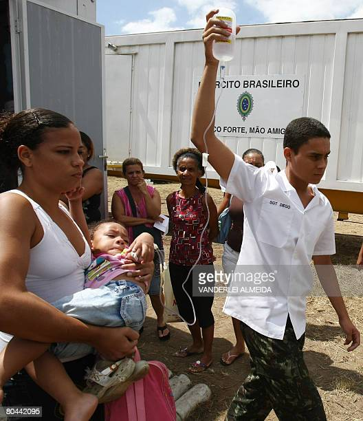 Suspected of being affected by dengue fever of the hemorrhagic sort threeyearold Maria Eduarda Lopes arrives to receive medical treatment at an Air...