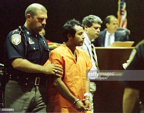 Suspected serial killer Angel Maturino Resendez is escorted out of a courtroom 23 July by Harris County Sheriff's Department Lt J Holden in Houston...