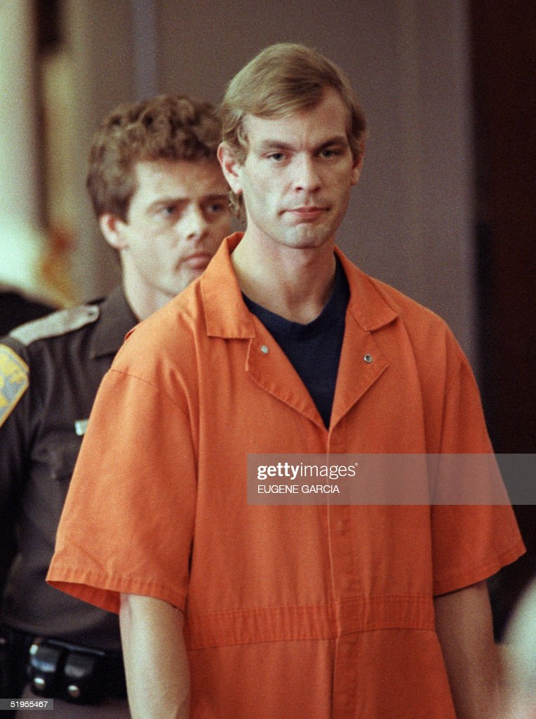 Suspected serial killer Jeffrey L. Dahmer enters the courtroom of judge Jeffrey A. Wagner 06 August 1991. Dahmer has been charged with eight additional counts of first-degree murder, bringing the number of homicides he is charged with to 12. The judge increased Dahmer's bail to five million dollars. He was sentenced to fifteen consecutive life terms or a total of 957 years in prison. Dahmer was killed by a fellow prisoner, Christopher Scarver, 28 November 1994 at Columbia Correctional Institution, Portage, Wisconsin.