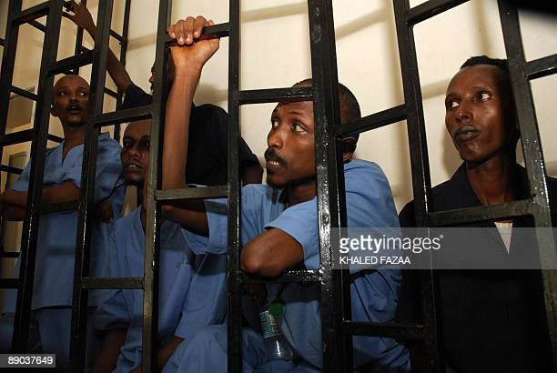 Suspected Somali pirates sit behind bars during the first hearing in their trial at Aden port court on July 15 2009 According to the United Nations...