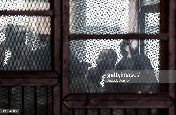 Suspects are seen behind the bars as the court of Cairo sentences 7 to death 3 to life 22 to 15 years prison and decides the absolution of 3 suspects...