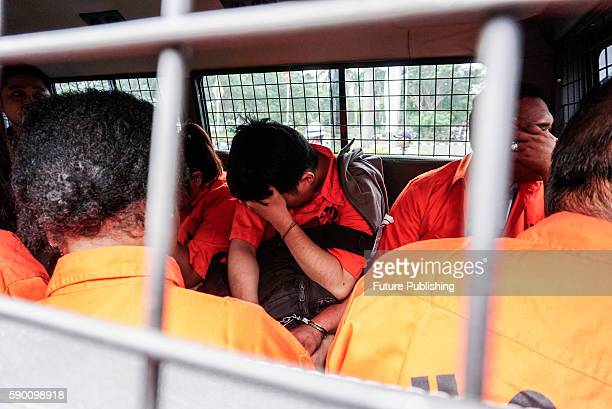 Suspects of human trafficking arrive at SoekarnoHatta Airport on August 16 2016 in Tangerang Indonesia 9 Suspects while smuggling 16 people from the...