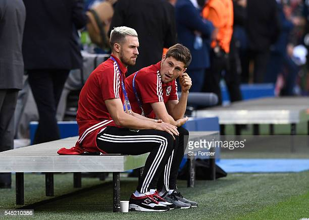 Suspended Aaron Ramsey and Ben Davies of Wales are seen prior to the UEFA EURO 2016 semi final match between Wales and Portugal at Stade des Lumieres...