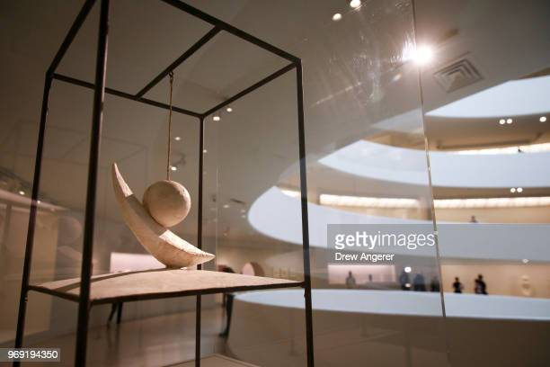 'Suspended Ball' a metal cord and plaster sculpture from 1931 is displayed at a retrospective exhibition of work by Swiss sculptor and artist Alberto...