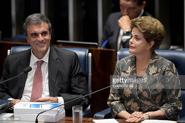 Suspended Brazilian President Dilma Rousseff gestures next to her attorney in the impeachment proceedings Jose Eduardo Cardozo before delivering her...