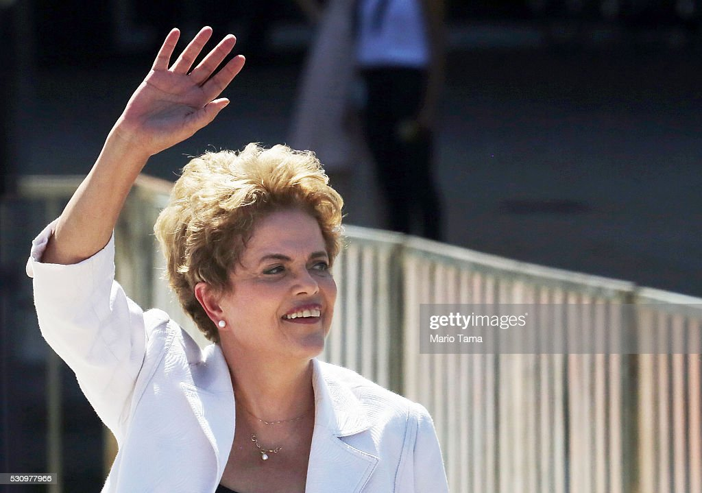 Suspended Brazilian President Dilma Rousseff waves before speaking to supporters at the Planalto presidential palace after the Senate voted to accept impeachment charges against Rousseff on May 12, 2016 in Brasilia, Brazil. Rousseff has been suspended from her presidential duties and will face a Senate trial for alleged manipulation of government accounts.
