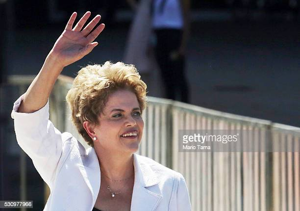 Suspended Brazilian President Dilma Rousseff waves before speaking to supporters at the Planalto presidential palace after the Senate voted to accept...