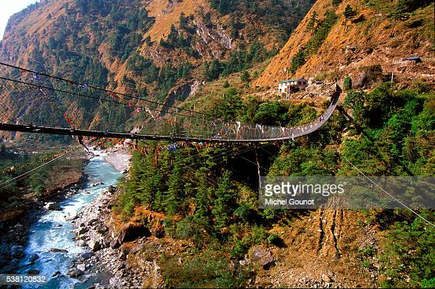 Suspended Bridge Crossing River in the Annapurna Himal