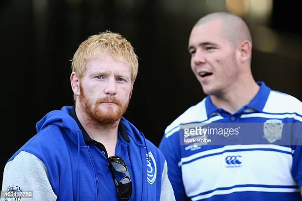 Suspended Bulldogs players James Graham and David Klemmer watch on during the warmup before the round six NRL match between the St George Illawarra...