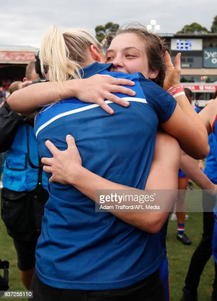 Suspended captain Katie Brennan of the Bulldogs celebrates with Acting captain Ellie Blackburn of the Bulldogs during the 2018 AFLW Grand Final match...