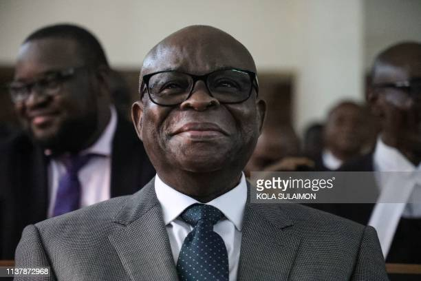 Suspended Chief Justice of Nigeria Walter Samuel Nkanu Onnoghen smiles as he appears before the Code of Conduct Tribunal during his final judgement...