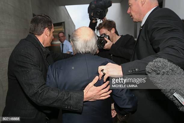 Suspended FIFA president Sepp Blatter is surrounded by security guards upon his arrival to a press conference on December 21 2015 in Zurich An ethics...