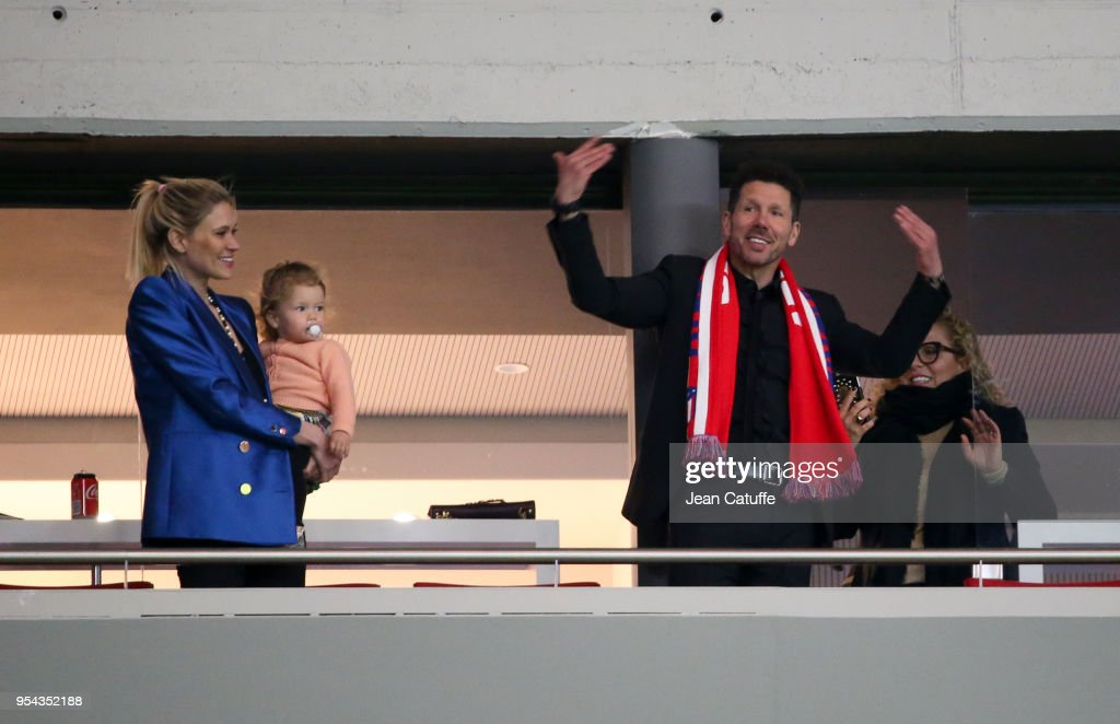 Suspended for the match, coach of Atletico Madrid Diego Simeone Madrid with his partner Carla Pereyra holding their daughter Francesca Simeone celebrate from the stands the qualification of his team for the final following the UEFA Europa League Semi Final second leg match between Atletico Madrid and Arsenal FC at Estadio Wanda Metropolitano on May 3, 2018 in Madrid, Spain.