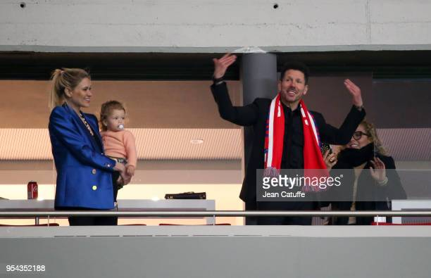Suspended for the match coach of Atletico Madrid Diego Simeone Madrid with his partner Carla Pereyra holding their daughter Francesca Simeone...